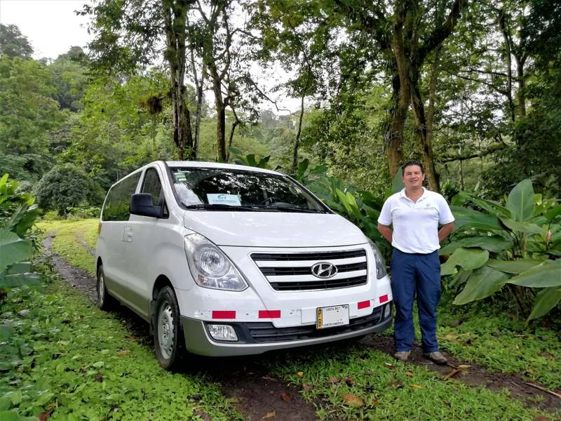 Morpho Van & driver with forest and vegetation background