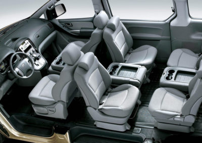 Inside view of 5 passenger van seats arranged face-to-face
